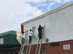 Workers painting exterior